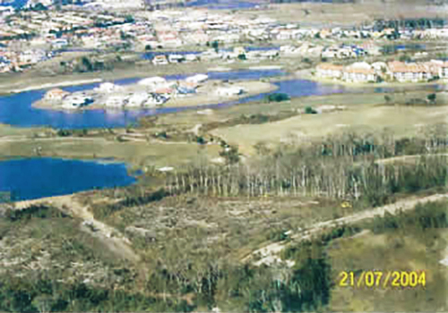 Bulldozers on the Pelican Links site undertaking pre-emptive clearing on 21 July 2004, taken by officers of the Caloundra City Council from a helicopter